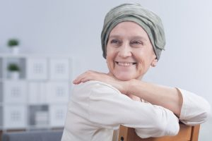 Shot of a smiling woman after a chemotherapy